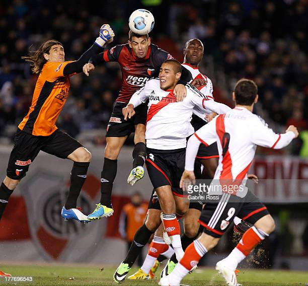 Gerardo Alcoba of Colon de Santa Fe fight for the ball with Jonathan Maidana of River Plate during a match between River Plate and Colon de Santa Fe...