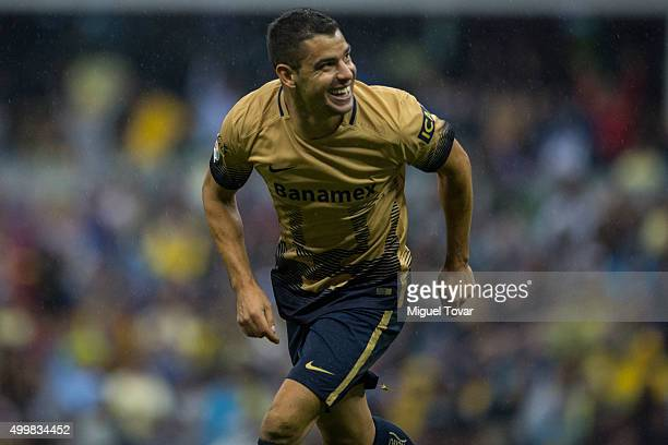 Gerardo Alcoba of Pumas celebrates after scoring the second goal of his team during the semifinals first leg match between America and Pumas UNAM as...