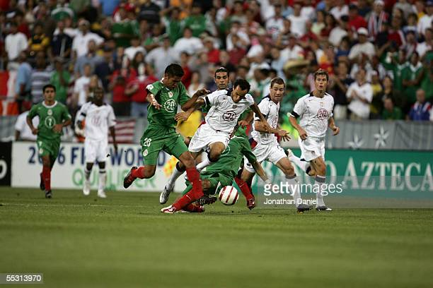Gerardo Galindo of Mexico pressures Landon Donovan of the USA during the 2006 World Cup Qualifying match at Crew Stadium on September 3 2005 in...