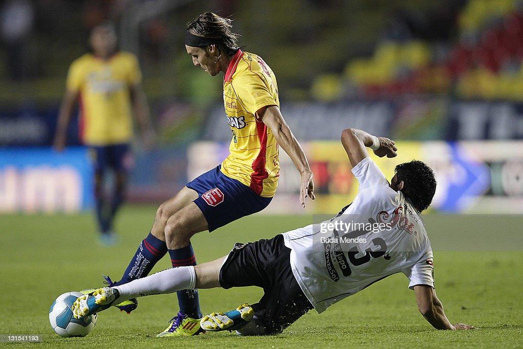 Gerardo Lugo of Monarcas Morelia struggles for the ball with Jorge Rodriguez of Jaguares during a match between Morelia and Jaguares as part of the...