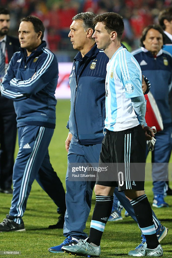 <a gi-track='captionPersonalityLinkClicked' href=/galleries/search?phrase=Gerardo+Martino&family=editorial&specificpeople=4362047 ng-click='$event.stopPropagation()'>Gerardo Martino</a>, coach of Argentina, and <a gi-track='captionPersonalityLinkClicked' href=/galleries/search?phrase=Lionel+Messi&family=editorial&specificpeople=453305 ng-click='$event.stopPropagation()'>Lionel Messi</a> of Argentina look dejected after the 2015 Copa America Chile Final match between Chile and Argentina at Nacional Stadium on July 04, 2015 in Santiago, Chile.
