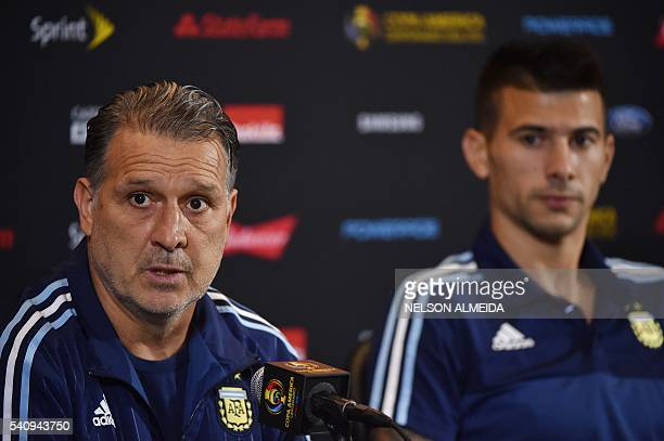 Gerardo Martino coach of Argentina and player Victor Cuesta address a press conference at Gillette Stadium in Boston Massachusetts on June 17 2016...