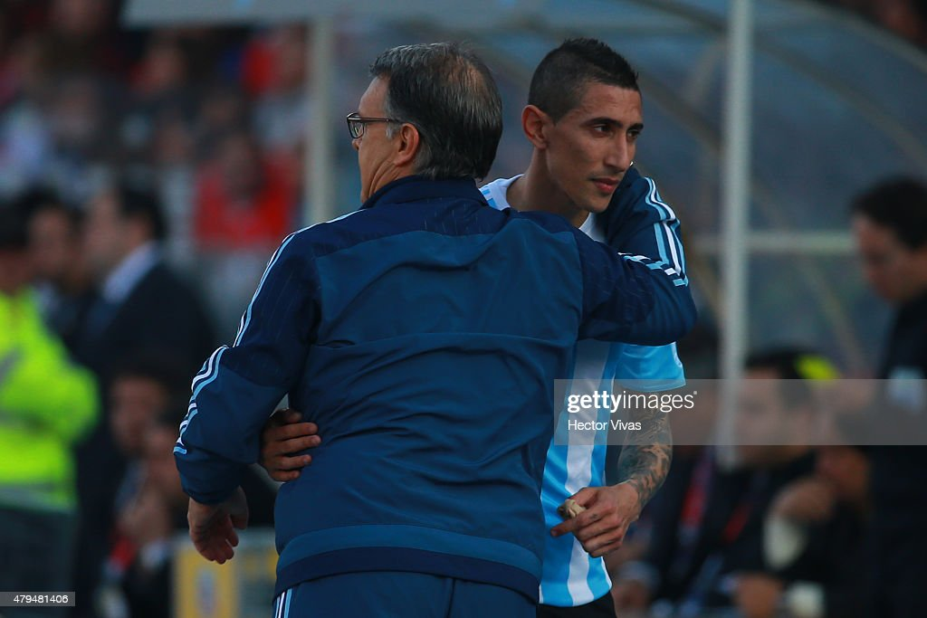 <a gi-track='captionPersonalityLinkClicked' href=/galleries/search?phrase=Gerardo+Martino&family=editorial&specificpeople=4362047 ng-click='$event.stopPropagation()'>Gerardo Martino</a>, coach of Argentina, hugs Angel di Maria during the 2015 Copa America Chile Final match between Chile and Argentina at Nacional Stadium on July 04, 2015 in Santiago, Chile.