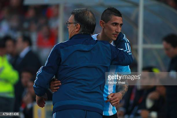 Gerardo Martino coach of Argentina hugs Angel di Maria during the 2015 Copa America Chile Final match between Chile and Argentina at Nacional Stadium...