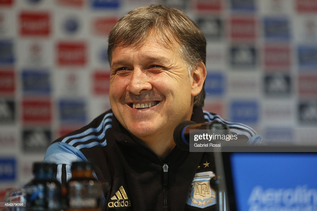 Gerardo Martino coach of Argentina smiles during a press conference at AFA's sports premises in Ezeiza on August 30, 2014 in Buenos Aires, Argentina. Argentina heads for Dusseldorf to play against Germany on September 3.