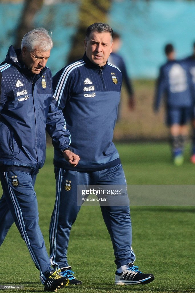 <a gi-track='captionPersonalityLinkClicked' href=/galleries/search?phrase=Gerardo+Martino&family=editorial&specificpeople=4362047 ng-click='$event.stopPropagation()'>Gerardo Martino</a> head coach of Argentina (R) looks on during a training session at Argentine Football Association (AFA) 'Julio Humberto Grondona' training camp on May 24, 2015 in Ezeiza, Argentina. Argentina will face Honduras on May 27, 2015.