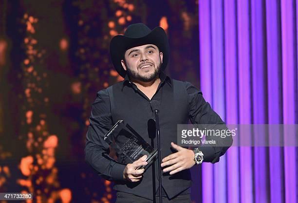 Gerardo Ortiz accepts award at the 2015 Billboard Latin Music Awards presented bu State Farm on Telemundo at Bank United Center on April 30 2015 in...