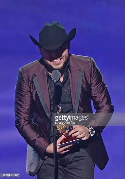 Gerardo Ortiz accepts award onstage at the 2015 Premios Lo Nuestros Awards at American Airlines Arena on February 19 2015 in Miami Florida