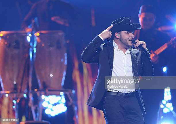Gerardo Ortiz performs on stage at the 2015 Premios Lo Nuestros Awards at American Airlines Arena on February 19 2015 in Miami Florida