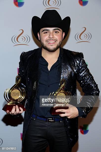 Gerardo Ortiz poses with awards at Univision's 28th Edition of Premio Lo Nuestro A La Musica Latina on February 18 2016 in Miami Florida