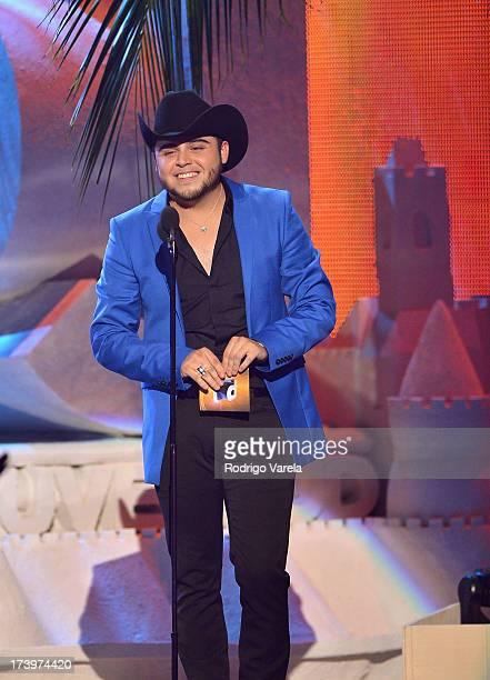 Gerardo Ortiz speaks onstage during the Premios Juventud 2013 at Bank United Center on July 18 2013 in Miami Florida