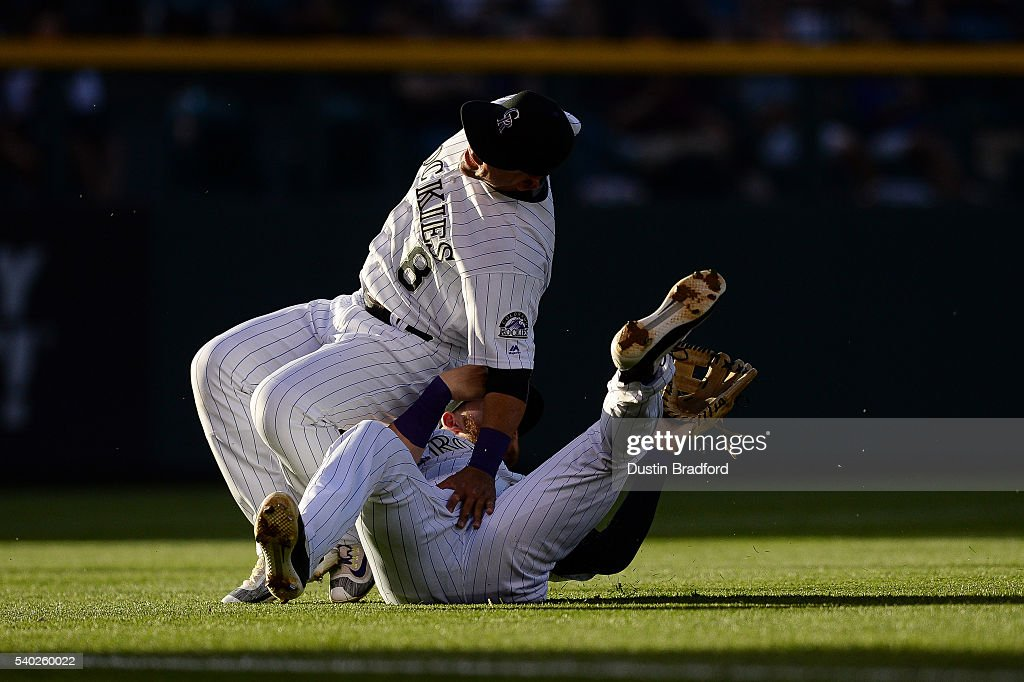 Gerardo Parra #8 and Nolan Arenado #28 of the Colorado Rockies collide as they play a shallow fly ball against the New York Yankees during a regular season interleague game at Coors Field on June 14, 2016 in Denver, Colorado. Parra was injured on the play and was removed from the game.