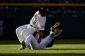 Gerardo Parra and Nolan Arenado of the Colorado Rockies collide as they play a shallow fly ball against the New York Yankees during a regular season...