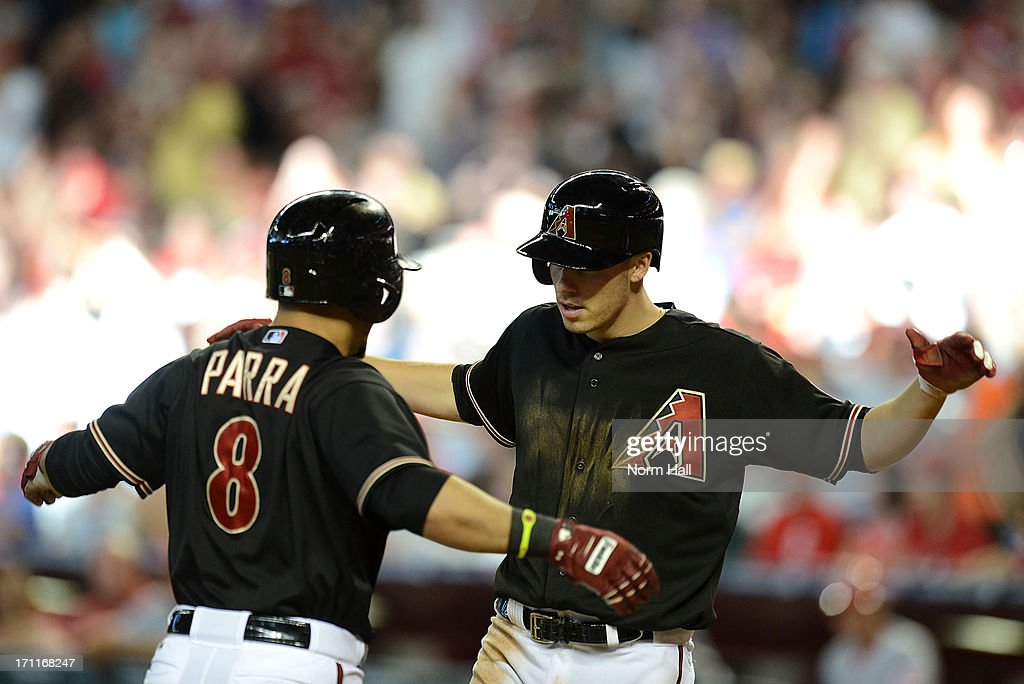 <a gi-track='captionPersonalityLinkClicked' href=/galleries/search?phrase=Gerardo+Parra&family=editorial&specificpeople=4959447 ng-click='$event.stopPropagation()'>Gerardo Parra</a> #8 and teammate Patrick Corbin #46 of the Arizona Diamondbacks celebrate Parra's home run against the Cincinnati Reds at Chase Field on June 22, 2013 in Phoenix, Arizona.