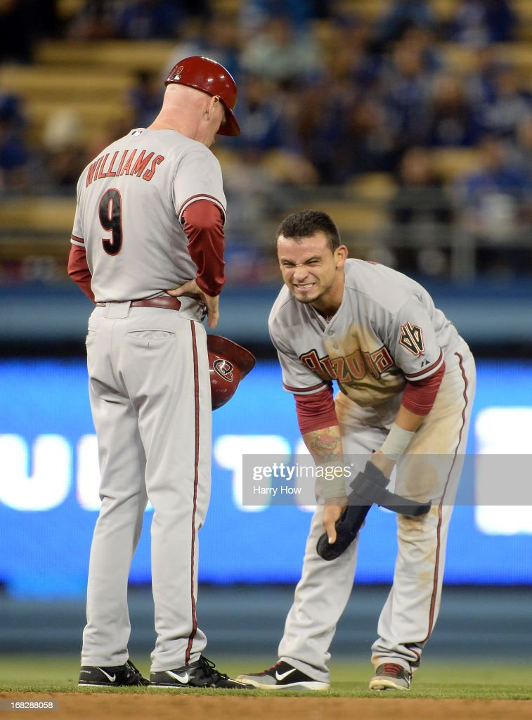 Gerardo Parra #8 of the Arizona Diamondbacks grimaces in front of third base coach Matt Williams #9 after he is tagged out attempting to steal second base during the sixth inning at Dodger Stadium on May 7, 2013 in Los Angeles, California.