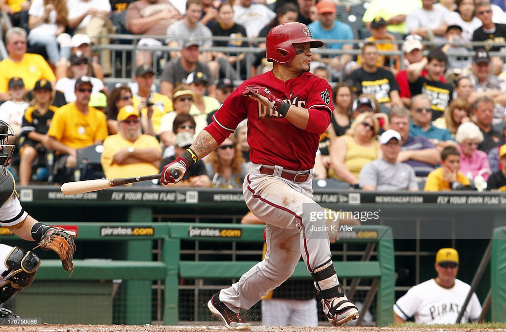 <a gi-track='captionPersonalityLinkClicked' href=/galleries/search?phrase=Gerardo+Parra&family=editorial&specificpeople=4959447 ng-click='$event.stopPropagation()'>Gerardo Parra</a> #8 of the Arizona Diamondbacks hits into a double play scoring a run in the sixth inning against the Pittsburgh Pirates during the game on August 18, 2013 at PNC Park in Pittsburgh, Pennsylvania.
