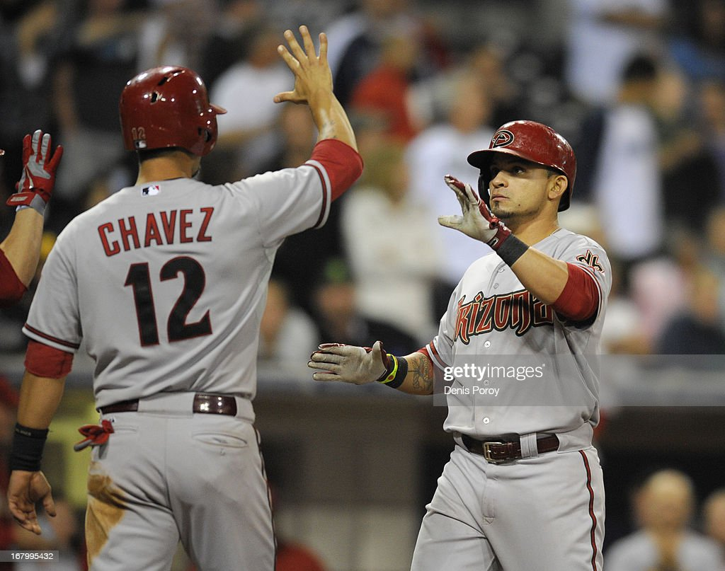 Gerardo Parra #8 of the Arizona Diamondbacks is congratulated by Eric Chavez #12 of the Arizona Diamondbacks after hitting a three-run home run in the ninth inning of a baseball game against the San Diego Padres at Petco Park on May 3, 2013 in San Diego, California.