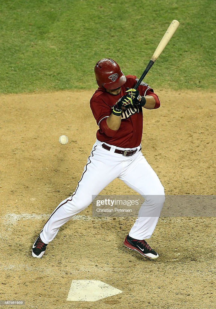 Gerardo Parra #8 of the Arizona Diamondbacks is hit by a pitch during the ninth inning of the MLB game against the Colorado Rockies at Chase Field on April 30, 2014 in Phoenix, Arizona. The Diamodbacks defeated the Rockies 5-4 in 10 innings.