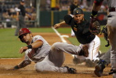 Gerardo Parra of the Arizona Diamondbacks is thrown out at home in the ninth inning against Russell Martin of the Pittsburgh Pirates during the game...