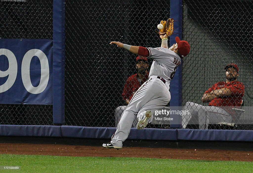 <a gi-track='captionPersonalityLinkClicked' href=/galleries/search?phrase=Gerardo+Parra&family=editorial&specificpeople=4959447 ng-click='$event.stopPropagation()'>Gerardo Parra</a> #8 of the Arizona Diamondbacks is unable to catch a triple off the bat of Omar Quintanilla #3 of the New York Mets in the eighth inning at Citi Field on July 1, 2013 at Citi Field in the Flushing neighborhood of the Queens borough of New York City.