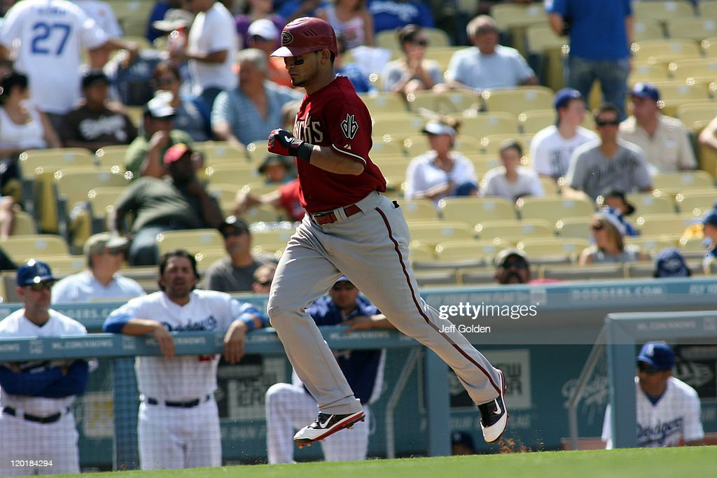 <a gi-track='captionPersonalityLinkClicked' href=/galleries/search?phrase=Gerardo+Parra&family=editorial&specificpeople=4959447 ng-click='$event.stopPropagation()'>Gerardo Parra</a> #8 of the Arizona Diamondbacks jogs to home plate after hitting a two-run home run to right center field against the Los Angeles Dodgers in the eighth inning of the game at Dodger Stadium on July 31, 2011 in Los Angeles, California.