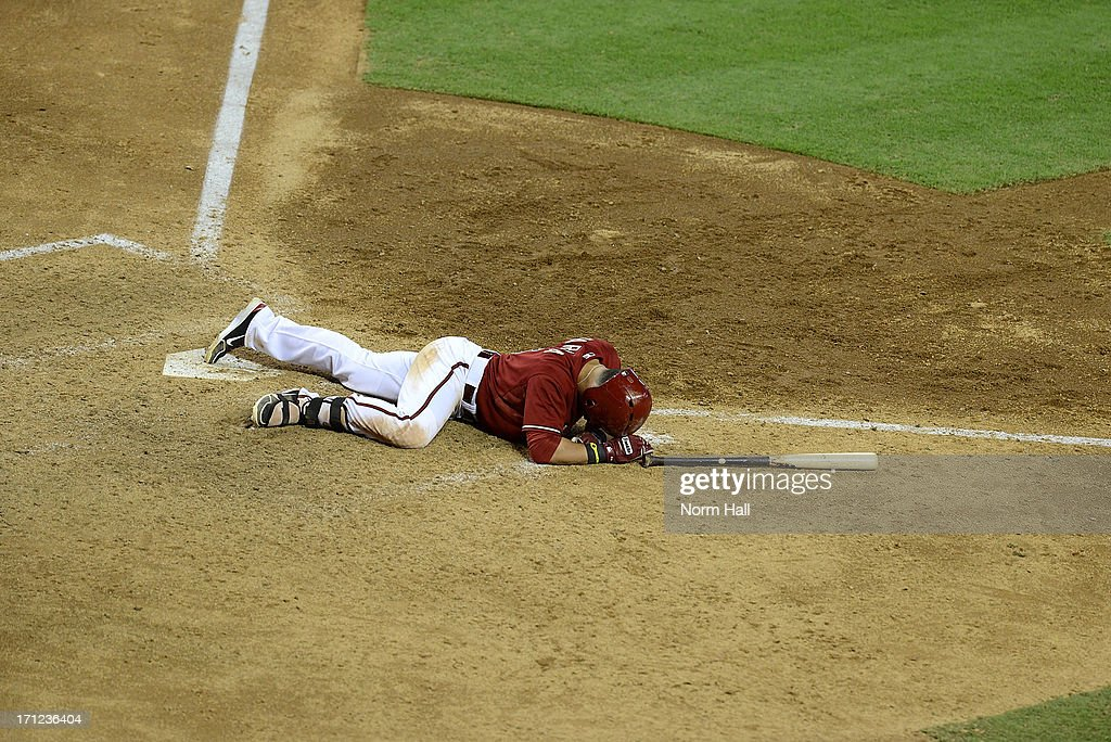 <a gi-track='captionPersonalityLinkClicked' href=/galleries/search?phrase=Gerardo+Parra&family=editorial&specificpeople=4959447 ng-click='$event.stopPropagation()'>Gerardo Parra</a> #8 of the Arizona Diamondbacks lies in the dirt after getting hit with a pitch against the Cincinnati Reds at Chase Field on June 23, 2013 in Phoenix, Arizona.