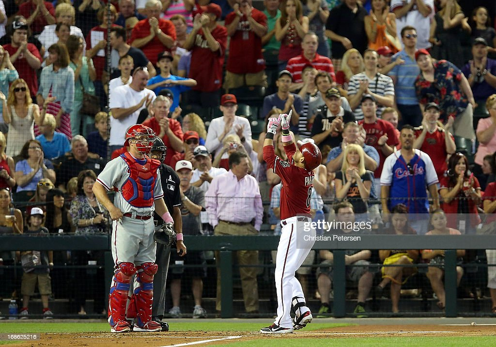 Gerardo Parra #8 of the Arizona Diamondbacks points to the sky after hitting a solo home run against the Philadelphia Phillies during the second inning of the MLB game at Chase Field on May 12, 2013 in Phoenix, Arizona.