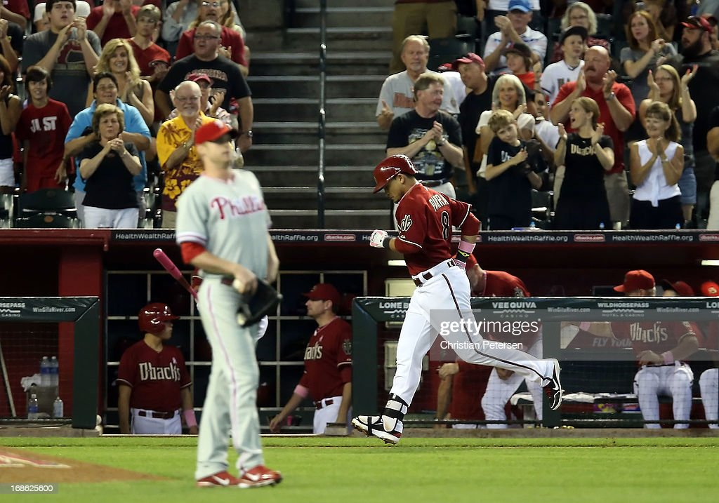Gerardo Parra #8 of the Arizona Diamondbacks rounds the bases after hitting a solo home run off starting pitcher Kyle Kendrick #38 of the Philadelphia Phillies during the second inning of the MLB game at Chase Field on May 12, 2013 in Phoenix, Arizona.