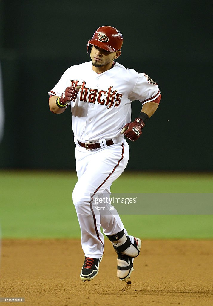 <a gi-track='captionPersonalityLinkClicked' href=/galleries/search?phrase=Gerardo+Parra&family=editorial&specificpeople=4959447 ng-click='$event.stopPropagation()'>Gerardo Parra</a> #8 of the Arizona Diamondbacks rounds the bases after hitting a home run in the first inning against the Cincinnati Reds at Chase Field on June 21, 2013 in Phoenix, Arizona.