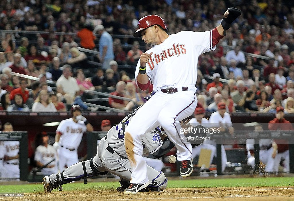 <a gi-track='captionPersonalityLinkClicked' href=/galleries/search?phrase=Gerardo+Parra&family=editorial&specificpeople=4959447 ng-click='$event.stopPropagation()'>Gerardo Parra</a> #8 of the Arizona Diamondbacks scores as catcher <a gi-track='captionPersonalityLinkClicked' href=/galleries/search?phrase=Wilin+Rosario&family=editorial&specificpeople=5734314 ng-click='$event.stopPropagation()'>Wilin Rosario</a> #20 of the Colorado Rockies drops the ball in the third inning at Chase Field on April 26, 2013 in Phoenix, Arizona.