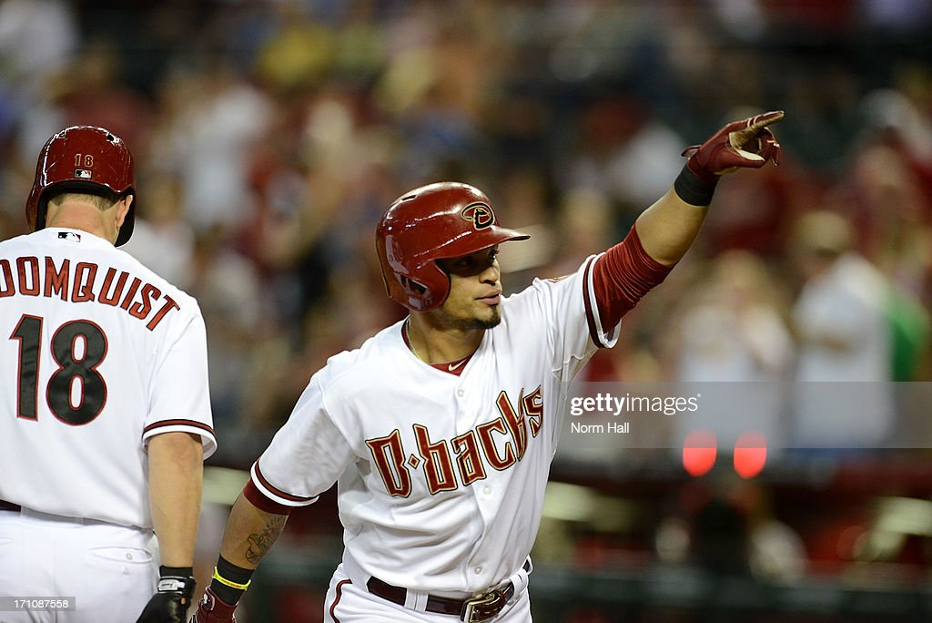 <a gi-track='captionPersonalityLinkClicked' href=/galleries/search?phrase=Gerardo+Parra&family=editorial&specificpeople=4959447 ng-click='$event.stopPropagation()'>Gerardo Parra</a> #8 of the Arizona Diamondbacks signals to the crowd after hitting a home run in the first inning against the Cincinnati Reds at Chase Field on June 21, 2013 in Phoenix, Arizona.