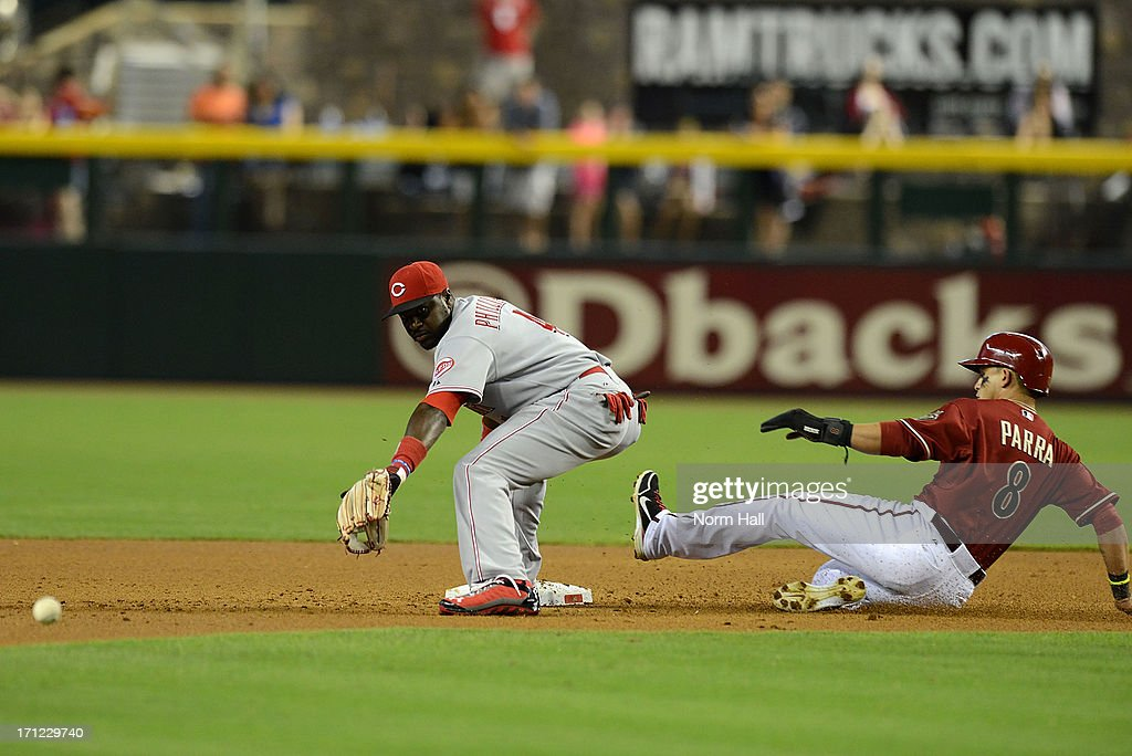 <a gi-track='captionPersonalityLinkClicked' href=/galleries/search?phrase=Gerardo+Parra&family=editorial&specificpeople=4959447 ng-click='$event.stopPropagation()'>Gerardo Parra</a> #8 of the Arizona Diamondbacks slides safely into second base as Brandon Phillips #4 of the Cincinnati Reds attempts to come up with the throw at Chase Field on June 23, 2013 in Phoenix, Arizona.