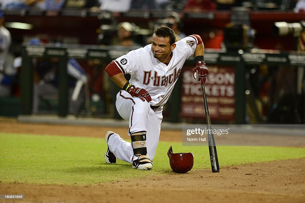 <a gi-track='captionPersonalityLinkClicked' href=/galleries/search?phrase=Gerardo+Parra&family=editorial&specificpeople=4959447 ng-click='$event.stopPropagation()'>Gerardo Parra</a> #8 of the Arizona Diamondbacks takes a knee after fouling a ball off his foot against the Los Angeles Dodgers at Chase Field on September 16, 2013 in Phoenix, Arizona.