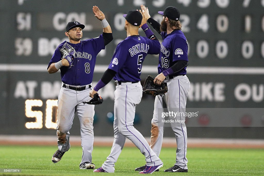 <a gi-track='captionPersonalityLinkClicked' href=/galleries/search?phrase=Gerardo+Parra&family=editorial&specificpeople=4959447 ng-click='$event.stopPropagation()'>Gerardo Parra</a> #8 of the Colorado Rockies, <a gi-track='captionPersonalityLinkClicked' href=/galleries/search?phrase=Carlos+Gonzalez+-+Amerikaanse+honkballer&family=editorial&specificpeople=7204259 ng-click='$event.stopPropagation()'>Carlos Gonzalez</a> #5 and <a gi-track='captionPersonalityLinkClicked' href=/galleries/search?phrase=Charlie+Blackmon&family=editorial&specificpeople=7519880 ng-click='$event.stopPropagation()'>Charlie Blackmon</a> #19 celebrate after defeating the Boston Red Sox 8-2 at Fenway Park on May 26, 2016 in Boston, Massachusetts.