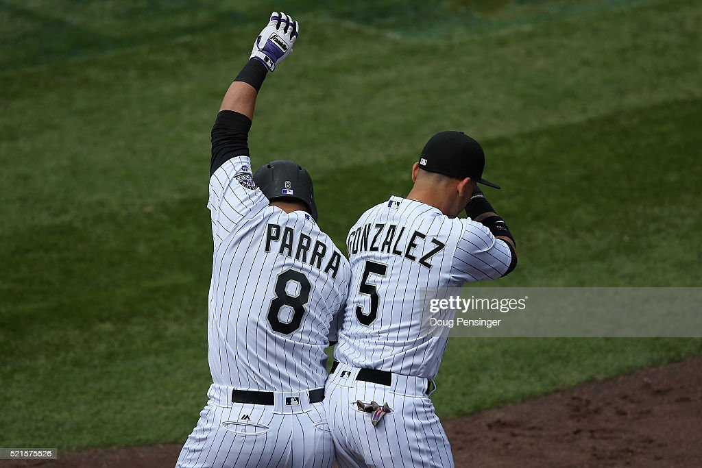 Gerardo Parra #8 of the Colorado Rockies celebrates his solo home run off of Matt Cain #18 of the San Francisco Giants with with Carlos Gonzalez #5 to tie the score 1-1 in the fifth inning at Coors Field on April 14, 2016 in Denver, Colorado. The Rockies defeated the Giants 11-6.