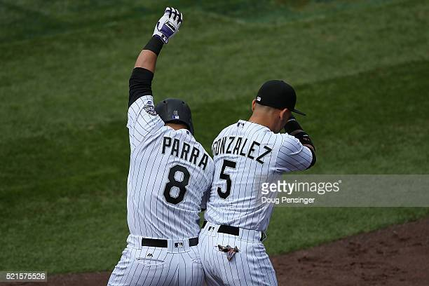 Gerardo Parra of the Colorado Rockies celebrates his solo home run off of Matt Cain of the San Francisco Giants with with Carlos Gonzalez to tie the...