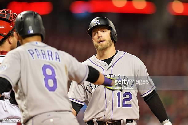 Gerardo Parra of the Colorado Rockies congratulates Mark Reynolds of the Colorado Rockies at home plate after Reynolds hit a tworun home run in the...