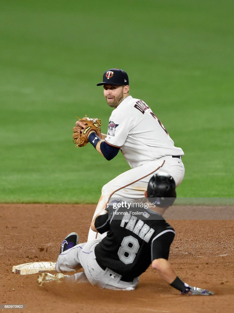 Gerardo Parra #8 of the Colorado Rockies is out at second base as Brian Dozier #2 of the Minnesota Twins looks to turn a double play during the sixth inning of the game on May 16, 2017 at Target Field in Minneapolis, Minnesota. The Rockies defeated the Twins 7-3.