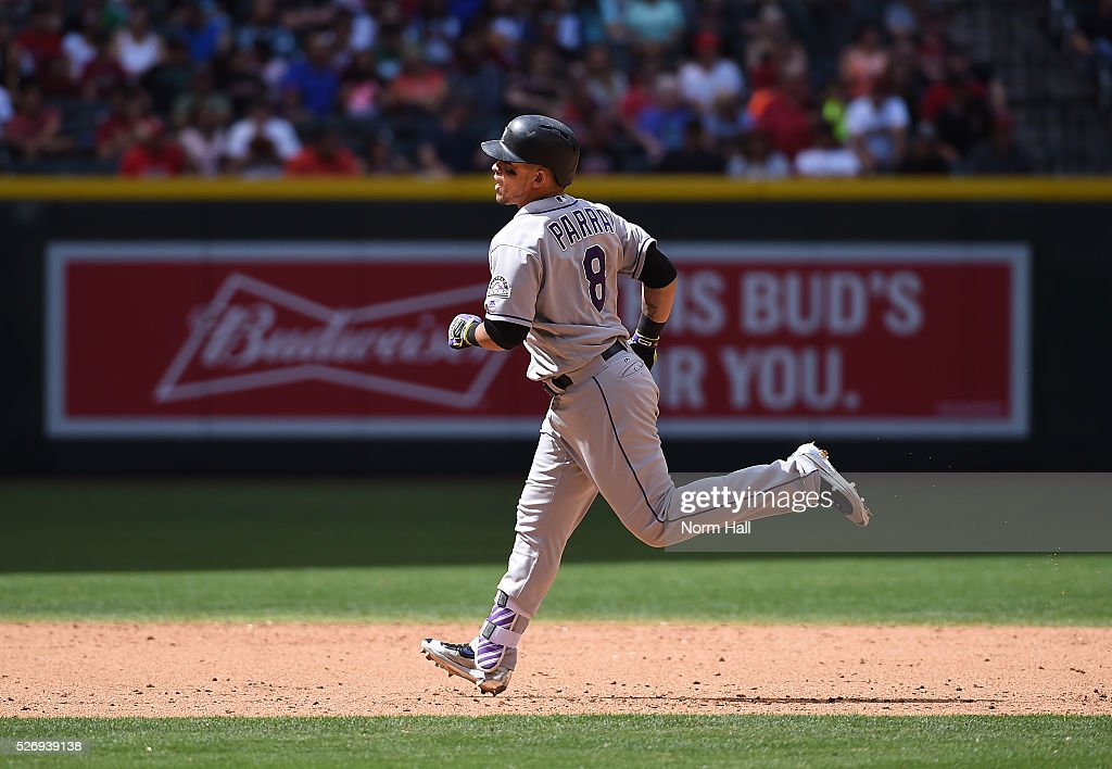 Gerardo Parra #8 of the Colorado Rockies rounds the bases after hitting a solo home run during the fifth inning against the Arizona Diamondbacks at Chase Field on May 01, 2016 in Phoenix, Arizona.