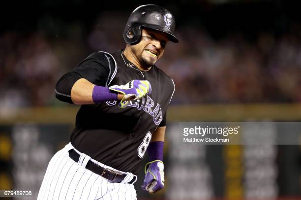 Gerardo Parra of the Colorado Rockies scores on a Dustin Garneau RBI double in the seventh inning against the Arizona Diamondbacks at Coors Field on...