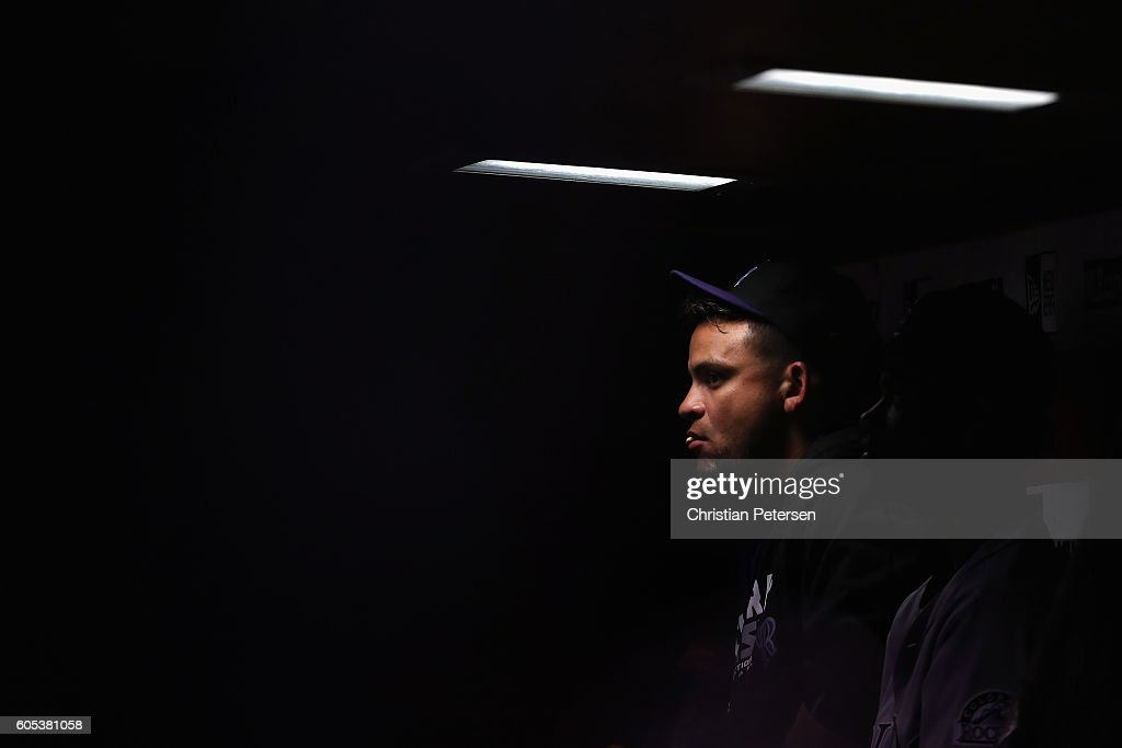 Gerardo Parra #8 of the Colorado Rockies sits in the dugout during the MLB game against the Arizona Diamondbacks at Chase Field on September 13, 2016 in Phoenix, Arizona.