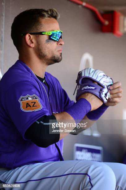 Gerardo Parra of the Colorado Rockies sits in the dugout during the spring training game against the Arizona Diamondbacks at Salt River Fields at...