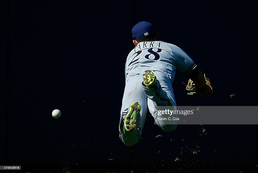 Gerardo Parra of the Milwaukee Brewers dives as he fails to catch this double hit by AJ Pierzynski of the Atlanta Braves in the second inning at...