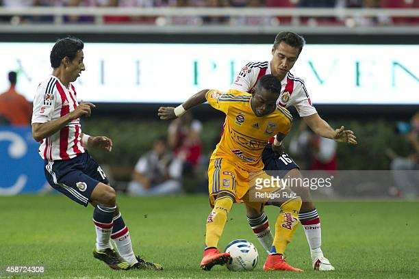 Gerardo Rodriguez of Chivas fights for the ball with Dario Burbano of Tigres during a match between Chivas and Tigres UANL as part of 16th round...