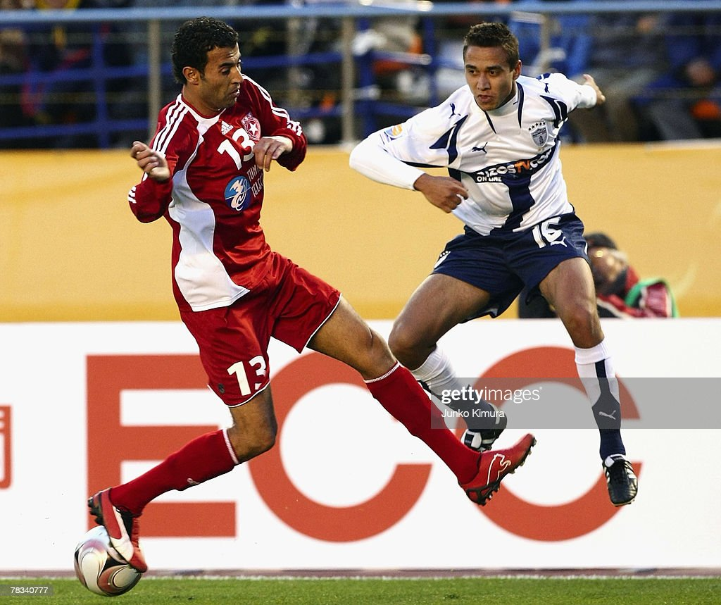 Gerardo Rodriguez of Pachuca and Sabeur Frej of Etoile Sportive du Sahel battle for the ball during the FIFA Club World Cup Japan 2007 match between...