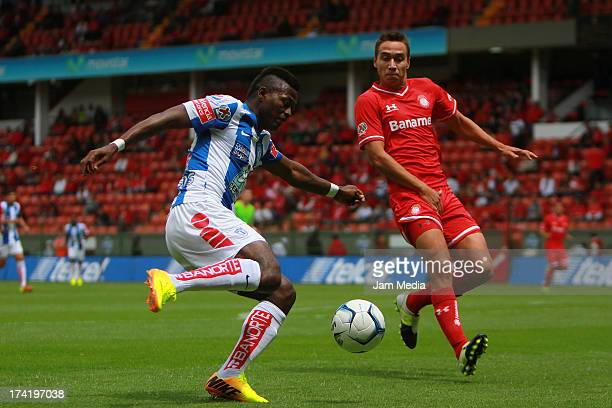 Gerardo Rodriguez of Toluca struggles for the ball with Duvier Riascos of Tijuana during the match between Toluca and Pachuca as part of the Apertura...