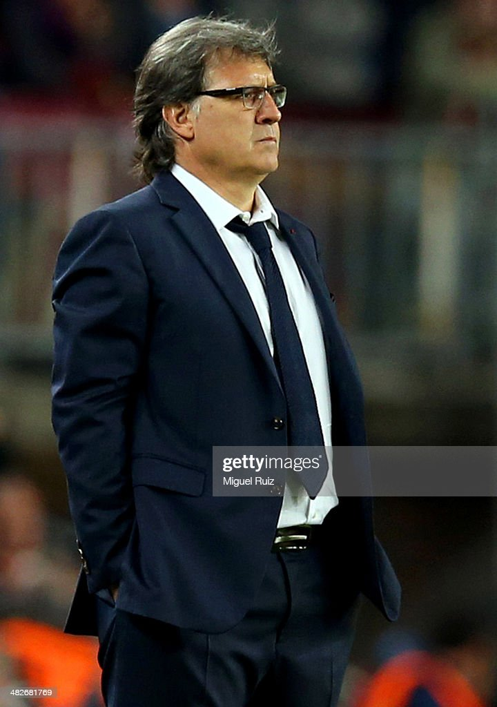 Gerardo Tata Martino, Head coach of FC Barcelona manages the team from the bench during the UEFA Champions League quarter final first leg between FC Barcelona and Club Atletico de Madrid at Nou Camp on April 1, 2014 in Barcelona, Spain.