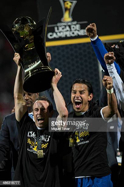 Gerardo Torrado and Gerardo Flores hold the trophy after winning the leg 2 of the final match between Cruz Azul and Toluca as part of the CONCACAF...