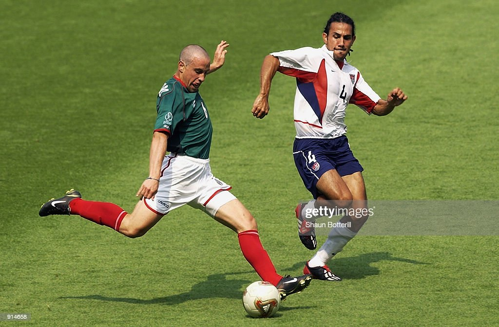 Gerardo Torrado of Mexico shoots past Pablo Mastroeni of the USA during the Mexico v USA, World Cup Second Round match played at the Jeonju World Cup Stadium, Jeonju, South Korea on June 17, 2002. The USA won 2-0.