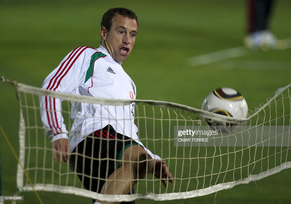 Gerardo Torrado, player of the Mexican national team, tries to pass a ball over a net during a training session at the Waterstone College in Johannesburg on June 5, 2010. Mexico will kick off the four-yearly tournament next Friday against host South Africa. AFP PHOTO/Omar TORRES